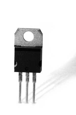 chip and pin: Black and white macro shot of an electronic device, isolated on white (transistor)