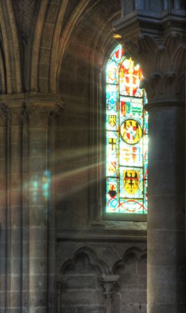 tinted glasses: Rays of light through stained glass in a church
