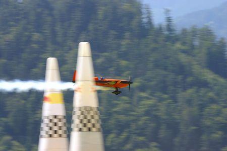 Aerobatics airplane reaching the finish line of a race. Stock Photo