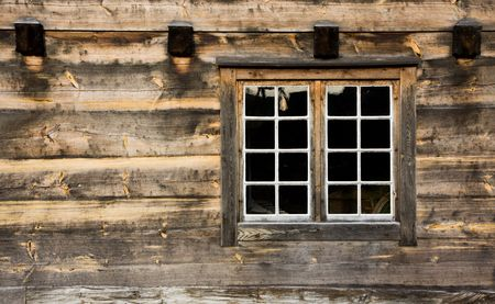 Window of a wooden cottage Stock Photo
