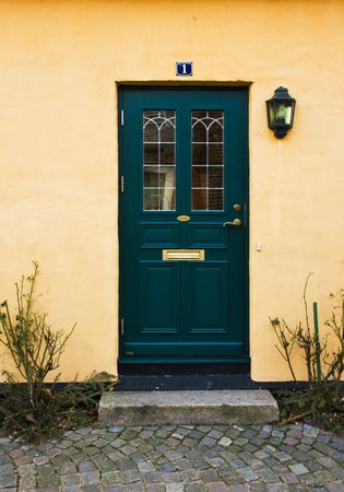front door: Green door of a welcoming home