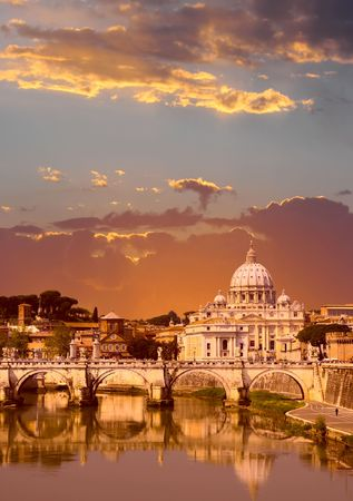 Sunset view of the Vatican with Saint Peters Basilica and SantAngelos Bridge (Rome, Italy)
