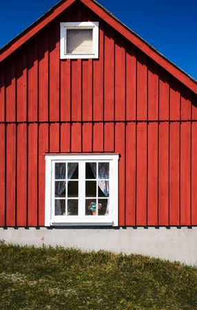 Facade of a vivid red cottage (Sweden)