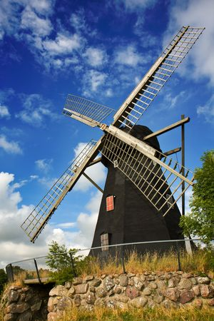 traditional windmill: Traditional windmill with cloudy blue skye (Sweden). Stock Photo
