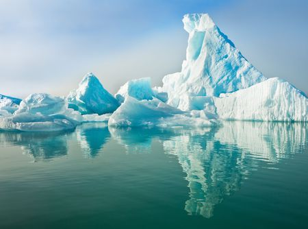 antarctic: Icebergs floating in calm water.  Horizontally framed shot.