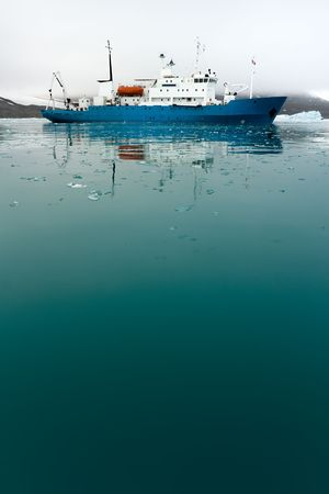 Icebreaker in icy water.  Vertically framed shot. Stock Photo