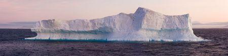 Large iceberg floating in sea. Horizontally framed shot. Stock Photo