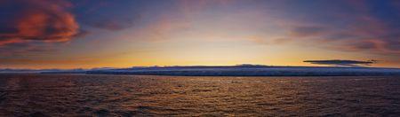 Frozen coastline at sunset.  Horizontally framed shot.