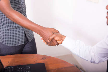 african american handshake: Businessmen are giving a handshake for a contract