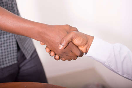 african american handshake: Two businessmen are giving a handshake for a contract