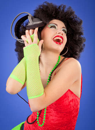 crazy woman: Beautiful woman with headphones Stock Photo