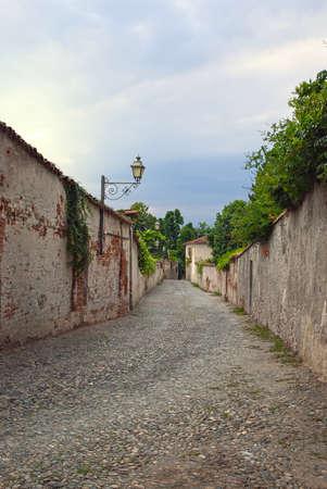 saluzzo: Narrow stone road between the city walls of Saluzzo, northern Italy Stock Photo