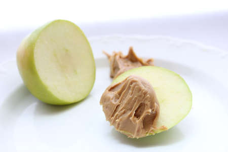 Green Apple with Peanut Butter Stock Photo