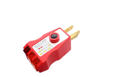 Isolated GFCI outlet tester that tests the ground fault by overloading circuit and tripping GFCI  Stock Photo
