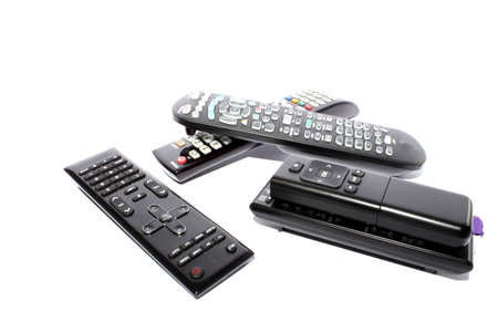 Isolated different remote controllers for television, dvd players, and cable  Stock Photo