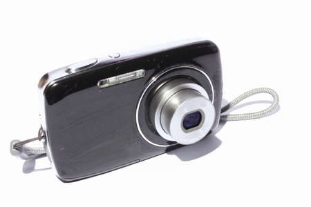 Isolated black and silver digital camera  photo