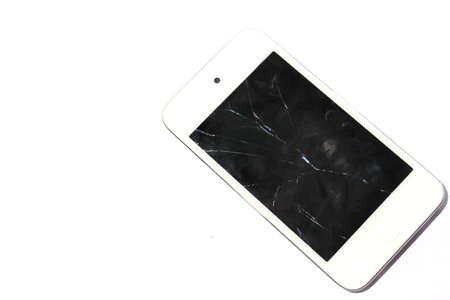 Isolated white smart phone with cracked, broke screen