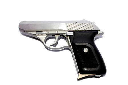 Isolated closeup of a silver 380 caliber handgun