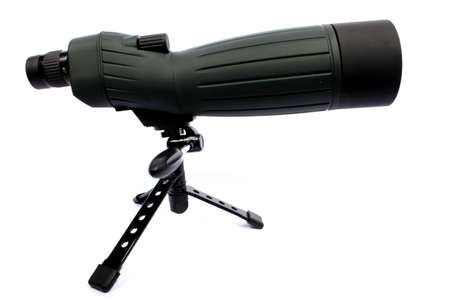 Isolated green and black spotting scope able to zoom in 60X  Stock Photo