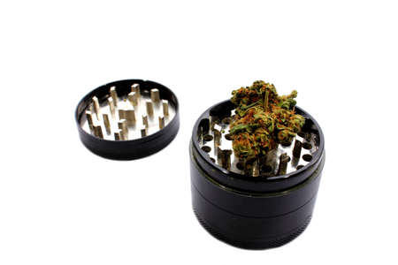 Isolated grinder used to grind marijuana into smaller pieces   photo
