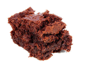 Isolated dessert chocolate brownie filled with chocolate chips   photo