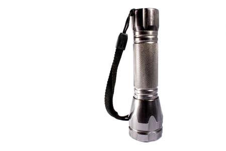 Isolated chrome flashlight used to illuminate dark areas   Stock Photo - 14506154