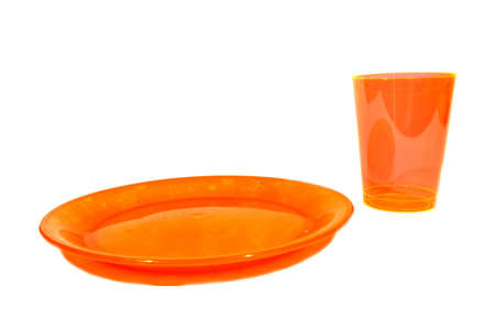 Isolated orange plastic cup and plate used for food and drink   photo