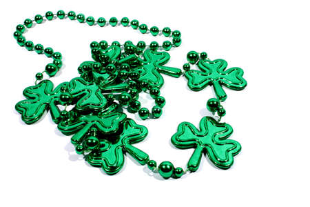 Isolated green mardi gras necklace with three leaf clovers