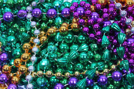 Closeup of gold, green, and purple Mardi Gras beads Stock Photo