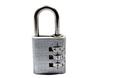 Isolated stainless steel combination padlock in the locked position  photo