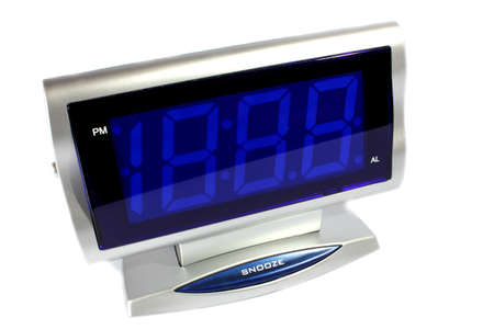 Isolated silver digital alarm clock with radio with blue display   Stock Photo - 14765453