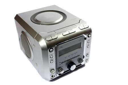 Isolated silver digital alarm clock with radio and CD player