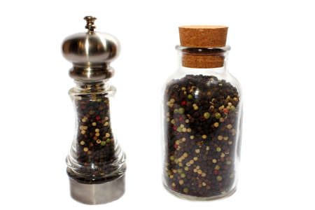 Isolated pepper shaker with spare pepper in jar