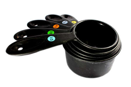 Isolated black plastic measuring cups used for cooking