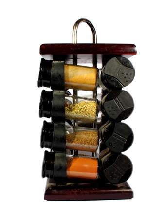 spice: Isolated cherry wood spice rack with many different spices   Stock Photo