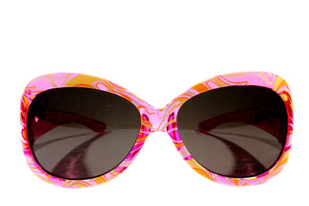 Isolated plastic pink girls sunglasses with dark lenses   photo