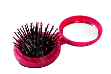 Isolated girls plastic pink brush and connected mirror