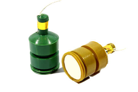 Isolated green and yellow party poppers used at parties like new years eve   Stock Photo - 14919914