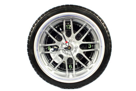 tire tread: Isolated tire wall clock with analog time keeping