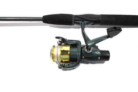 Isolated green fishing pole and open faced reel Stock Photo - 15237875