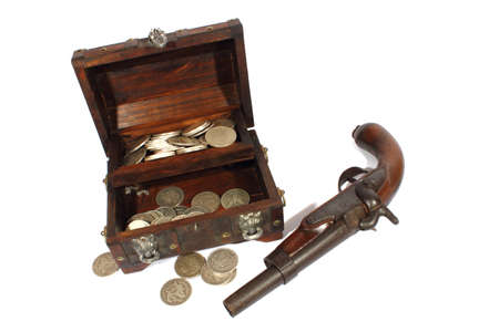 Isolated treasure box with a pirate pistol laying beside it  photo