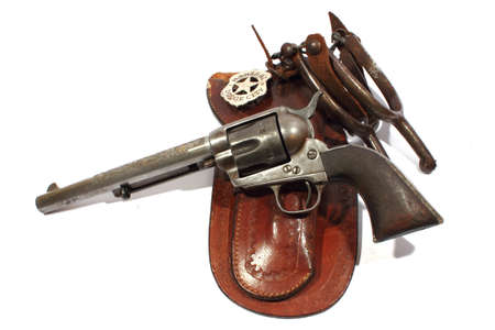 Isolated handgun with holster, spurs, and marshall badge