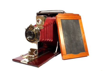 viewfinder vintage: Isolated antique camera that slides out from box Stock Photo