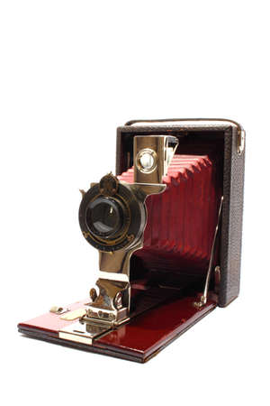Isolated antique camera that slides out from box photo