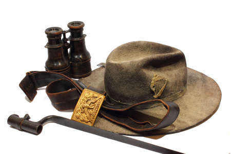 bayonet: Isolated antique Civil War artifacts including hat, binoculars, bayonet, and belt