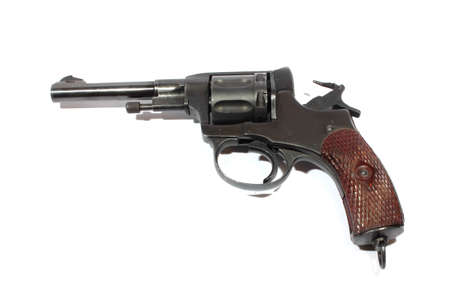 cocked: Isolated antique handgun cocked and ready to fire