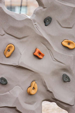 Close up view of a rock wall used to climb and play