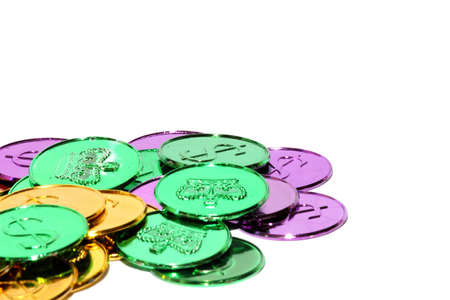 colorful beads: Isolated view of different mardi gras coins Stock Photo