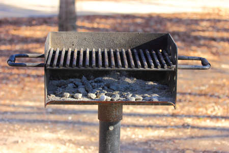 outdoor fireplace: Fire pit at a park used for BBQ