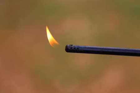 A close up view of a flame coming from an extended lighter Stock Photo